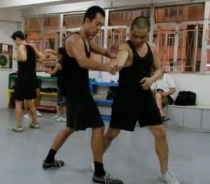 Alan and Kwan playing Gaw Sau